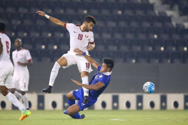 Thailand striker Siroch Chatthong, right, in action against Qatar.