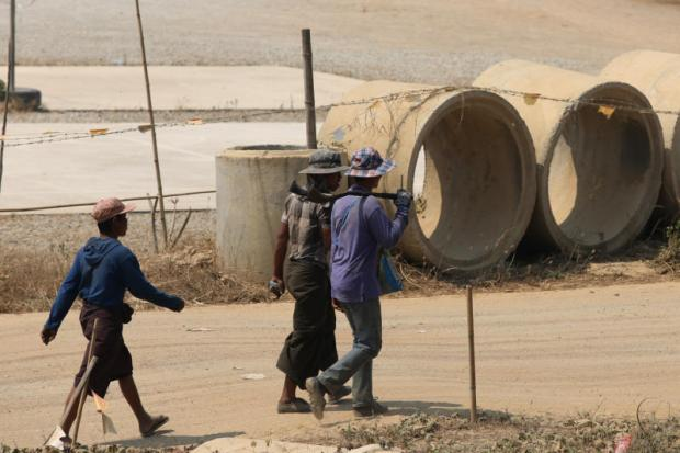 Workers walk to the Dawei development in Myanmar. New committees will be set up to move the multibillion-dollar megaproject forward. PATTANAPONG HIRUNARD