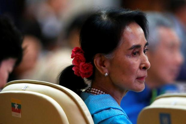 Myanmar leader Aung San Suu Kyi attends the Asean Summit gala dinner in Vientiane, Laos on Wednesday. (Reuters photo)
