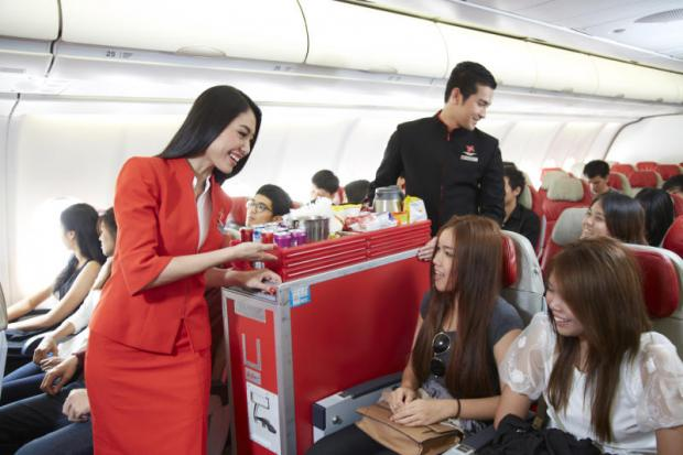 Thai AirAsia X cabin attendants at work. Cabin crew are increasingly at risk of abuse by unruly passengers.