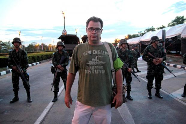 CAMERA, ACTION: Nick Nostitz in front of soldiers blocking the entry to the red shirt protest camp which the military dispersed after the coup was announced on May 22, 2014.