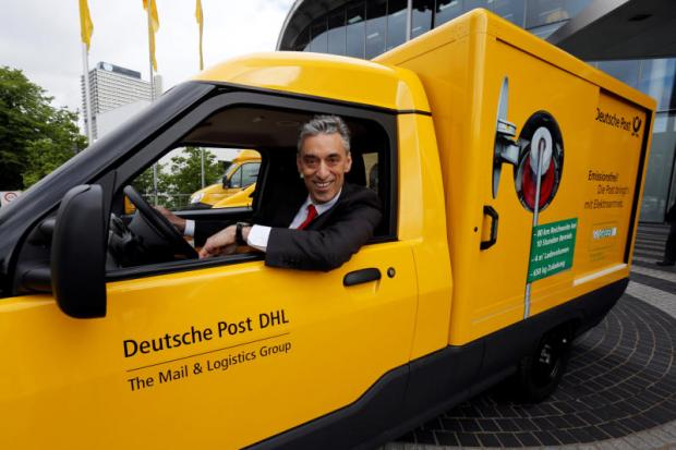 Frank Appel, CEO of Deutsche Post AG looks out of a StreetScooter in this file photo.REUTERS