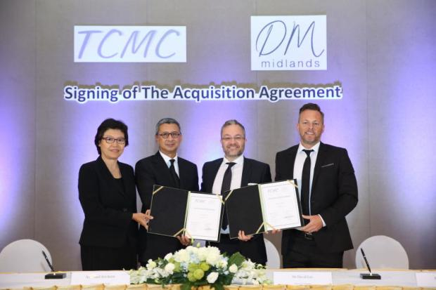 From left, TCMC executive director M.L. Walliwan Varavarn, TCMC chairman Pimol Srivikorn, DM Midlands chief executive David Lee, and DM Midlands design director Mark Smith attend the acquisition signing for the furniture firm.