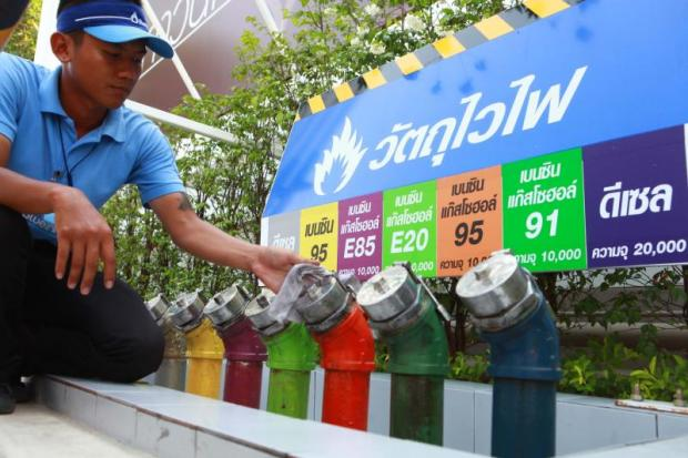 A man checks pipes at a PTT station on Srinakarin Road. The government says production of ethanol is likely to drop this month.SOMCHAI POOMLARD
