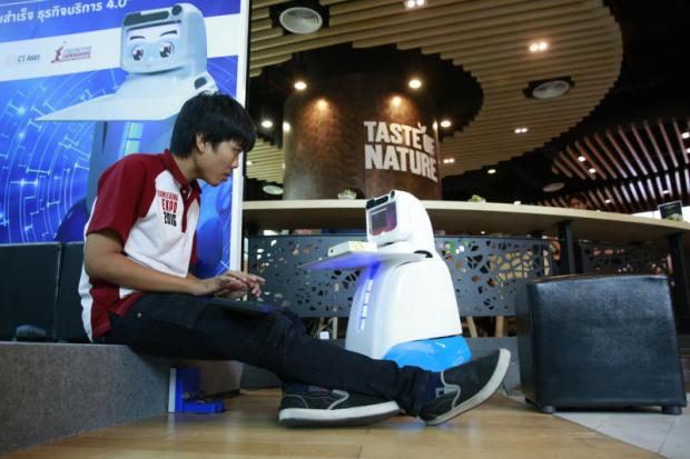 A technician tests a Dinsow Tebo robot, created to promote the use of robotics in services, an innovation that complies with Thailand 4.0.PATTANAPONG HIRUNARD