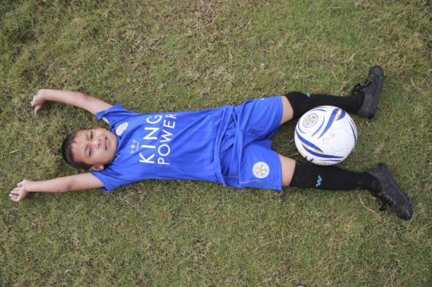 getting his kicks: After a widely watched TV appearance, seven-year-old Suvin, or Nong Pee, became an overnight sensation for his football skills, receiving an invitation to join the national Thai team. (Photos by Taweechai Tawatpakorn)