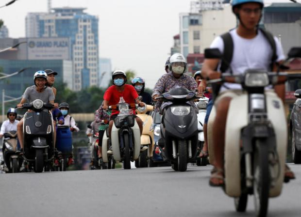 Left As more Vietnamese acquire the means to upgrade from motorcycles to cars, the need for better roads and infrastructure will become more acute. (Photos: Reuters)