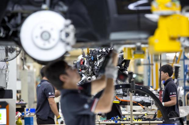 BMW employees at the Rayong plant. The carmaker is expanding its capacity to produce more plug-in hybrid electric vehicles. KRIT PROMSAKA NA SAKOLNAKORN