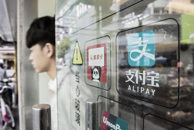 Signage for Alipay payment service, an affiliate of Alibaba Group Holding Ltd, is displayed on a store entrance in Shanghai. Alipay processed 100,000 transactions per second in 2016 in markets worldwide.(Bloomberg photo)