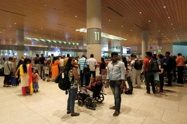 Passengers wait for their luggage at the Chhatrapati Shivaji International Airport in Mumbai on Tuesday.(Reuters photo)