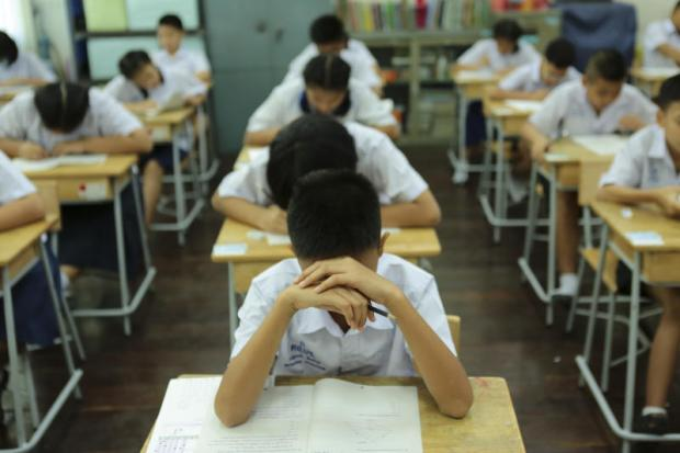 put to the test: Students take the Ordinary National Educational Test at Wat Benchamabophit School in Bangkok to assess their overall academic proficiency.