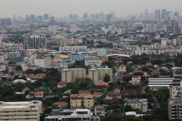 Older buildings abound in many areas of Bangkok. Experts say rising land prices have led developers to buy old buildings and renovate them. PATTARACHAI PREECHAPANICH