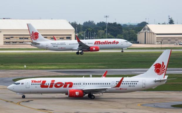 Boeing 737-900ERs of Thai Lion Air and Malindo, both LCCs under Indonesia's Lion Group, taxiing at Bangkok's Don Mueang airport, billed as the busiest LCC hub in Southeast Asia. LCCs are gaining bigger share in Thailand's airline traffic.