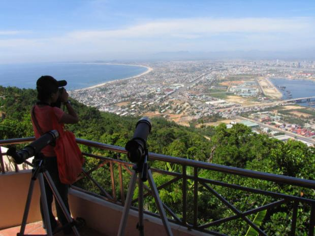 A visitor takes photographs from a viewpoint above Danang, the Vietnamese coastal city that marks the eastern terminus of the East-West Economic Corridor. Photo: Pongpet Mekloy