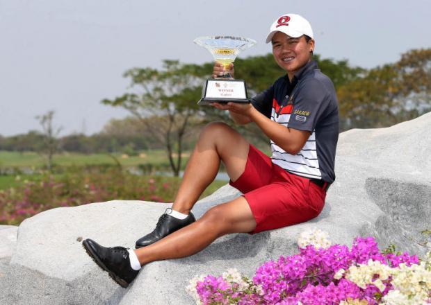 Kusuma Meechai holds the Singha E-San Open winner's trophy.