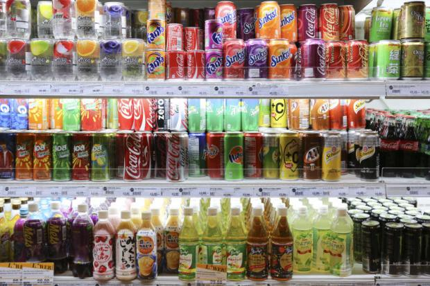 Soft drinks for sale at a convenience store. Drinks makers are braced for intense competition this summer. PATIPAT JANTHONG