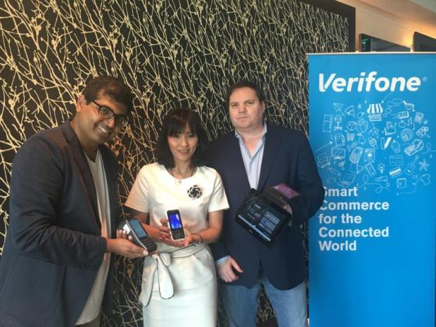 Mr Robson (right) with Verifone executives Apinya Sookthawarakorn and Valli Lakshmanan. The company plans to introduce three electronic data capture products in Thailand this year.