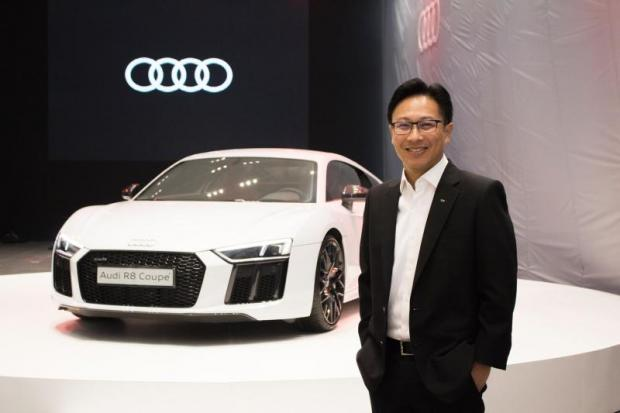 Mr Krisada poses with an Audi R8 Coupe. He says Audi can be a good alternative in the luxury car segment for Thai buyers.