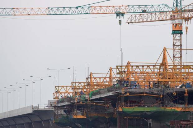 An expressway construction site. TMB's research house expects private investment to remain low and weaken economic growth this year. PANUMAS SANGUANWONG