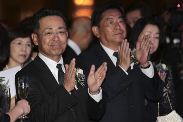 Kyoichi Tanada (right), former president of Toyota Thailand, stands with his successor, Michinobu Sugata, at last night's changeover ceremony in Bangkok. PATIPAT JANTHONG