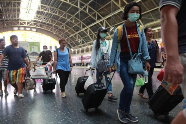 Passengers arrive at Hua Lamphong station after Songkran. The World Bank says Thai GDP will struggle to reach its full growth potential. Wichan Charoenkiatpakul