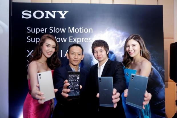 Satoshi Mekata (second left), Sony's head of Thai mobile sales, presents the latest Xperia XZs with super-slow-motion video.