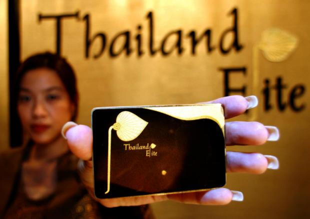 A woman presents the Thailand Elite Card, which allows for long-term visas and enables discounts on a variety of services to wealthy foreigners. APICHART JINAKUL