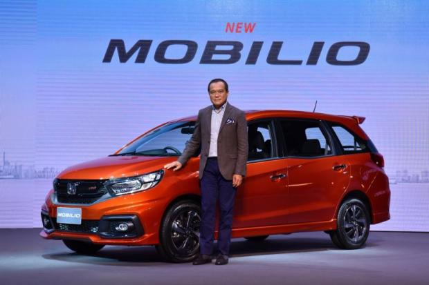 Mr Pitak poses with a Honda Mobilio, an innovative sub-compact MUV.