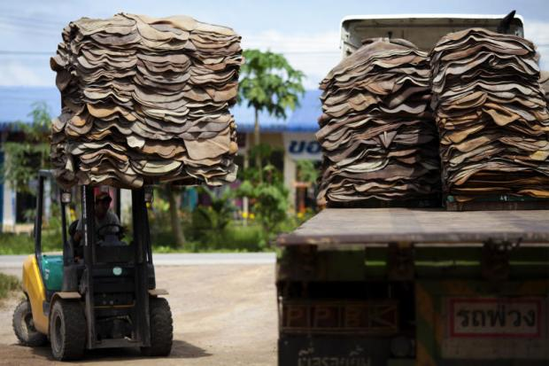 A man drives a forklift to unload rubber sheet at a market in Surat Thani province. Rubber producer Sri Trang is increasing production capacity to take advantage of rising demand. PATIPAT JANTHONG
