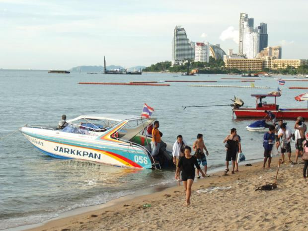 Boats provide rides at Pattaya Beach in Chon Buri province. The city faces a long-term battle in altering its image. SAROT MEKSOPHAWANNAKUL
