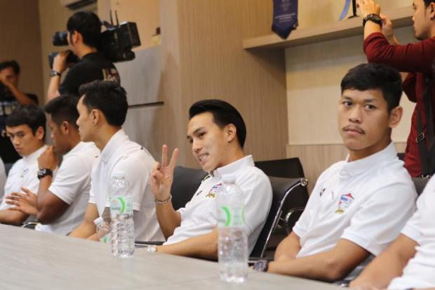 Forward Teerathep Winothai (second right) is one of 22 players who reported for the first day of the training camp at the Football Association of Thailand head office on Monday.