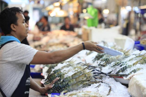 A vendor sells seafood products at Or Tor Kor market in Bangkok.PORNPROM SATRABHAYA