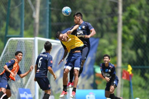 Striker Sirod Chatthong heads the ball during practice at the national team's training camp yesterday.