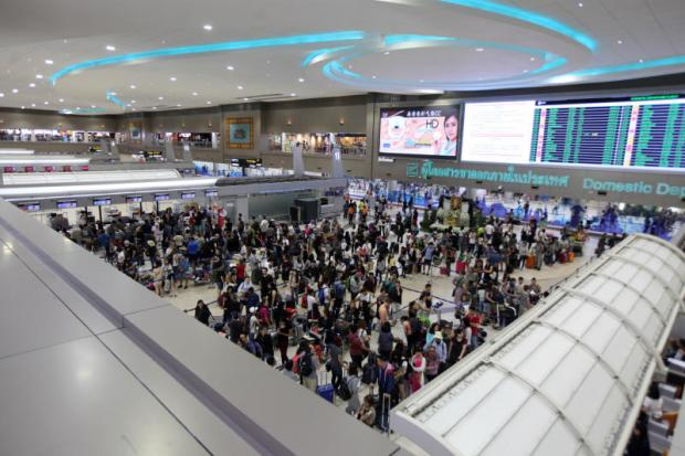 Travellers pack into Don Mueang airport, the region's largest low-cost carrier hub which is operating beyond its designed capacity. THITI WANNAMONTHA
