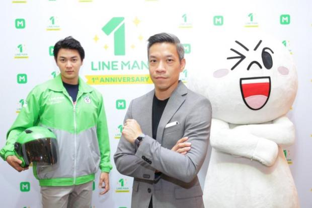 Ariya Banomyong (right), managing director of Line Thailand, celebrates the first anniversary of Line Man. Business potential for the delivery service app is huge, he says.