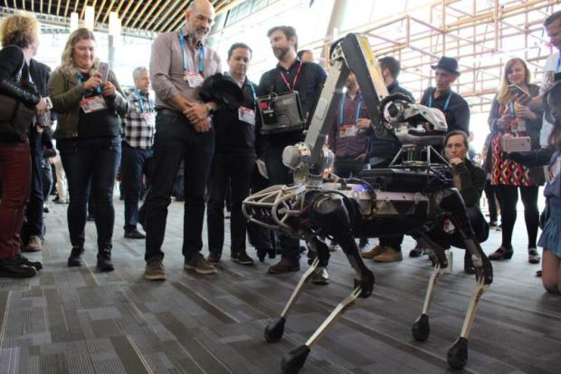 Boston Dynamics' Spot robot mingles with the crowd at the TED Conference in Vancouver, Canada on April 25, 2017.