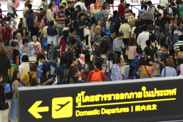 Passengers throng at Don Mueang airport. The Tourism and Sports Ministry says the baht's appreciation will weigh on inbound tourism.PATTANAPONG HIRUNARD