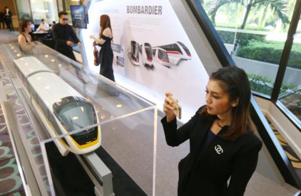 A Yellow Line train model on display at a contract signing. Inflated property prices from big-ticket infrastructure will soon be subject to tax. KITJA APICHONROJAREK