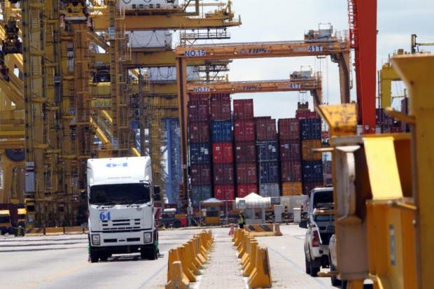 Cranes work to load cargo containers at the Laem Chabang port.APICHART JINAKUL