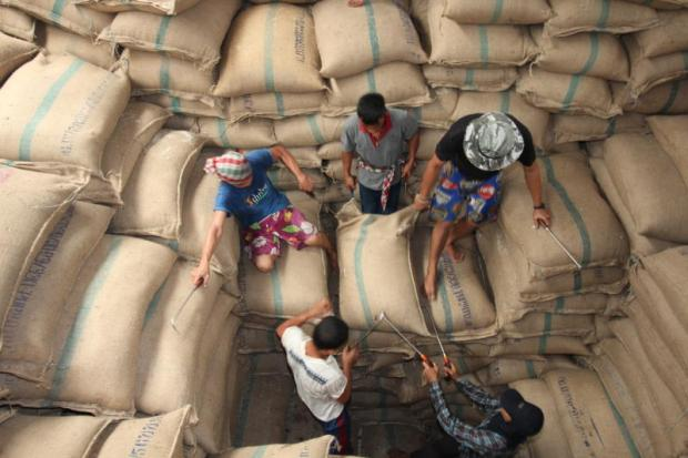 Labourers work in a rice warehouse in Ayutthaya province.SUNTHORN PONGPAO