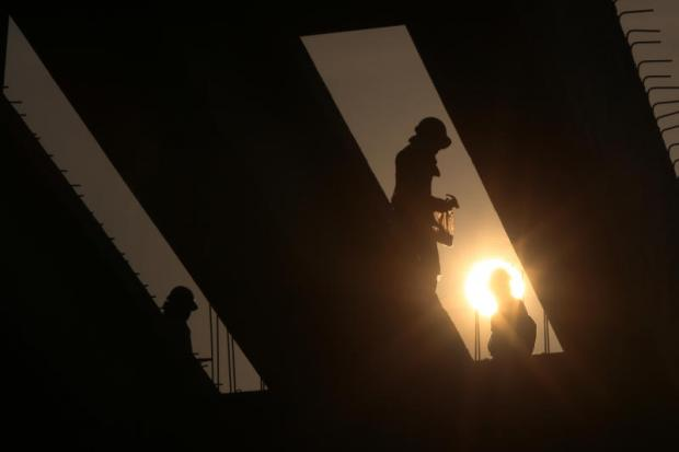 Workers at an infrastructure construction site in Bangkok.NATTAPOL LOVAKIJ