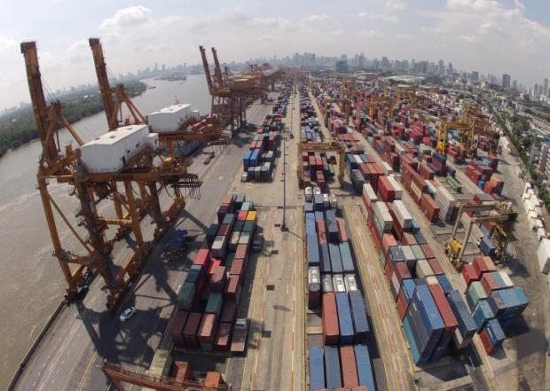 An overhead view of cargo containers at Bangkok port. A robust baht is one factor which risk weighing on strong export growth momentum.