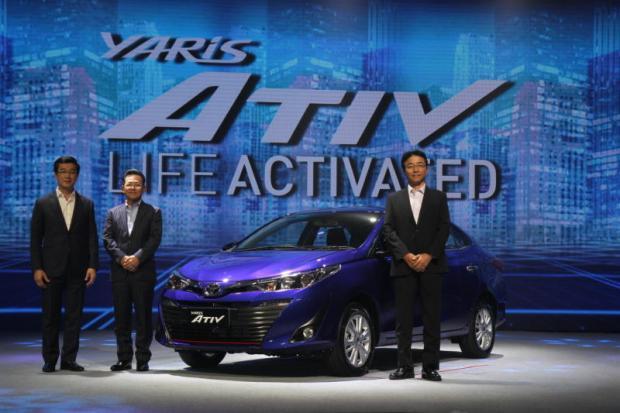 Toyota Motor Thailand president Michinobu Sugata (centre), with chief engineer Takatomo Suzuki (right) and executive vice-president Vudhigorn Suriyachantananont at yesterday's world debut of the Yaris Ativ sedan.