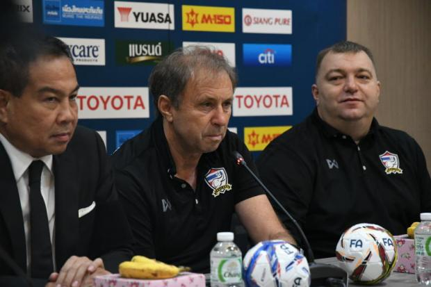 FAT president Somyot Poompunmuang, left, and coach Milovan Rajevac, centre.
