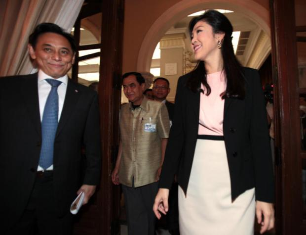 In this file photo from 2013, then commerce minister Boonsong Teriyapirom, left, walks alongside prime minister Yingluck Shinawatra at Government House. Boonsong was sentenced to 42 years in prison on Friday for his handling of fake government-to-government rice deals.CHANAT KATANYU