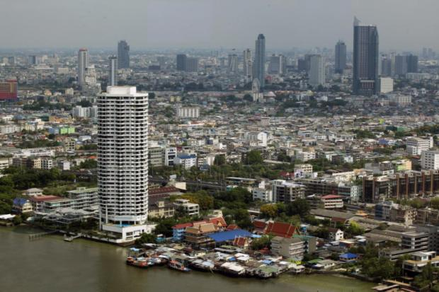 Residential areas and high-rise buildings in Bangkok. The new property tax is delayed again. PORNPROM SATRABHAYA