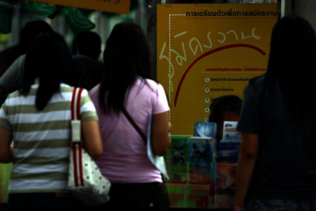 Job applicants seek opportunities at an employment fair. The unemployment rate rose to 1.22% in the second quarter from 1.08% a year earlier.NATTHITI AMPRAWAN
