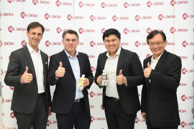 DKSH executive Fabrice Goetschmann, left, and Tofusan managing director Suranam Parnichakarn, 2nd from right. DKSH will distribute Tofusan soymilk across the country.