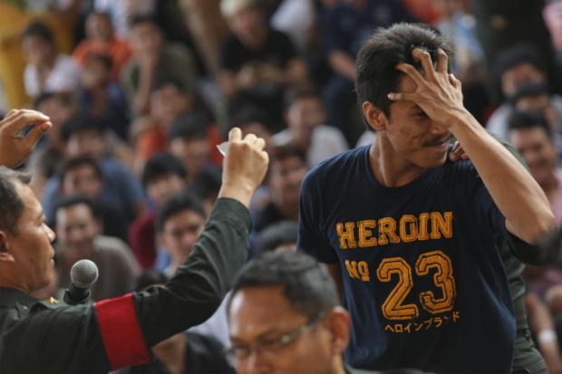 A man reacts upon finding out via a lottery system that he will be conscripted into the military at a venue in the capital in April last year.PATIPAT JANTHONG