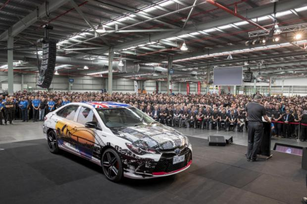 In this photo provided by Toyota Australia, the last Toyota car produced in Australia is displayed for gathered workers in Melbourne yesterday. (Photo from Toyota Australia via AP)